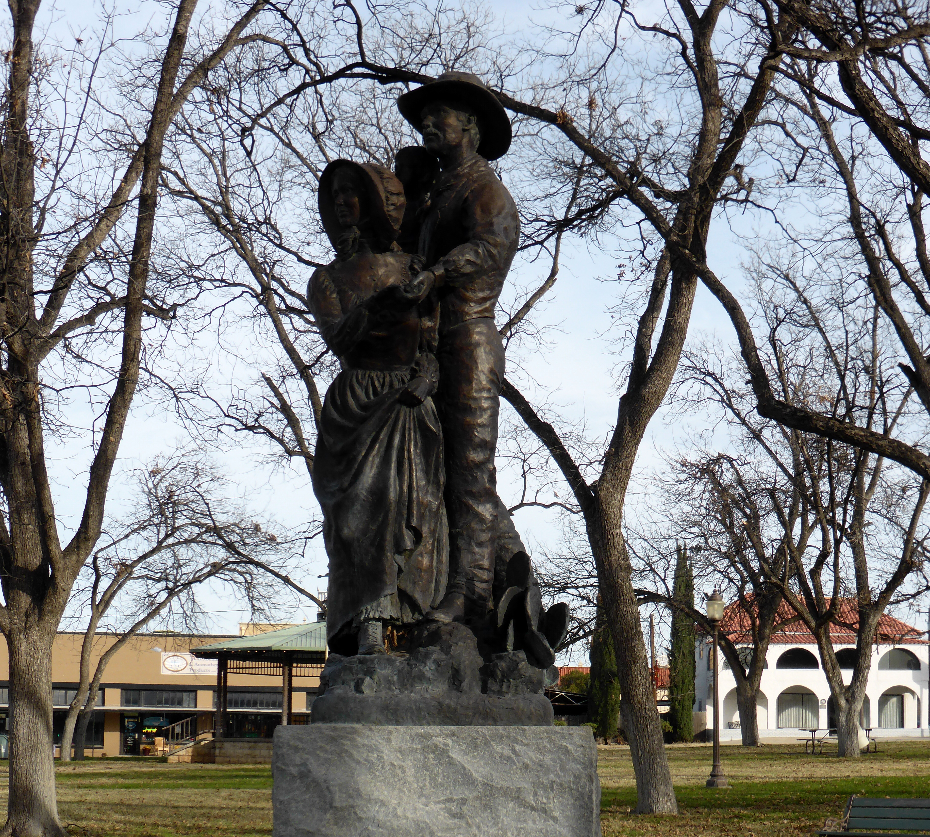 Judy Black sculpture of a pioneer family rests in the shadow of the ...